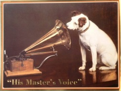 vintage photo of Victrola with listening dog