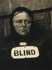 vintage photo of blind woman wearing sign