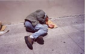 Homeless Man Sleeping on Sidewalk
