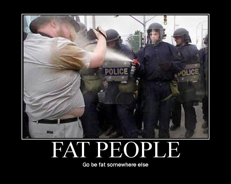 Picture of police with water cannon attacking fat man